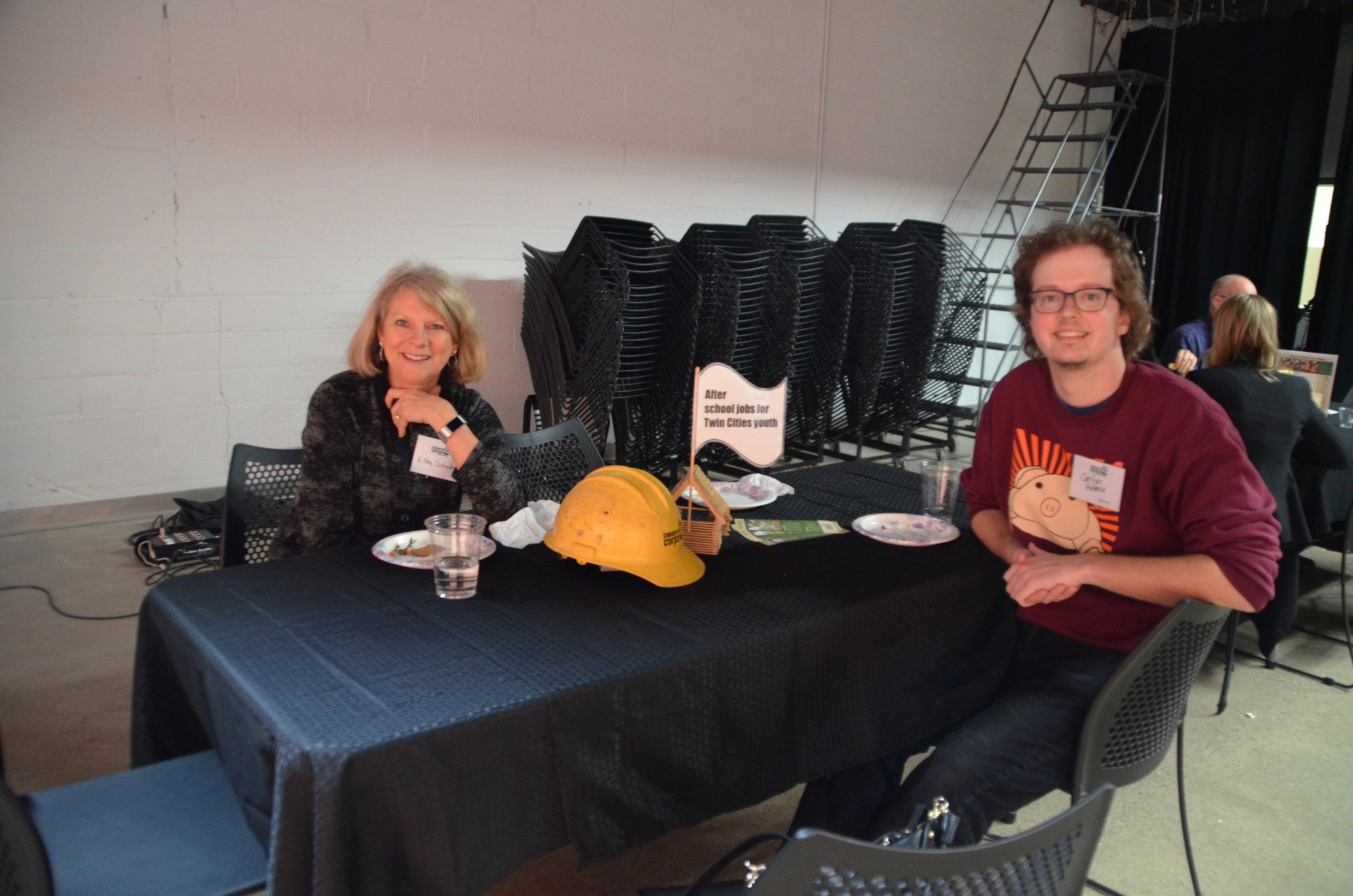 Two people sitting at table