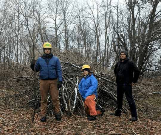 Standing in front of brush pile