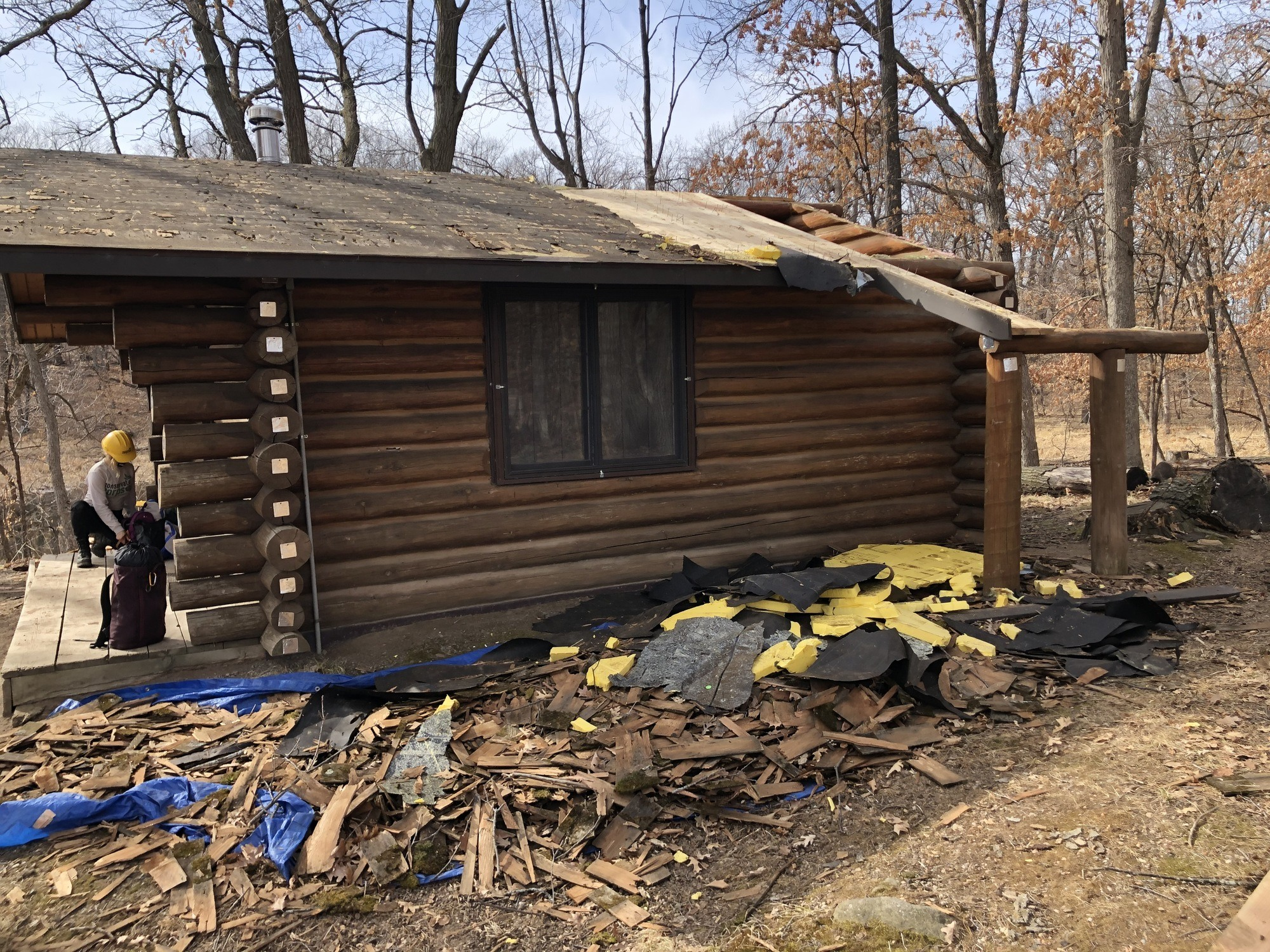Cabin with part of roof missing in fall