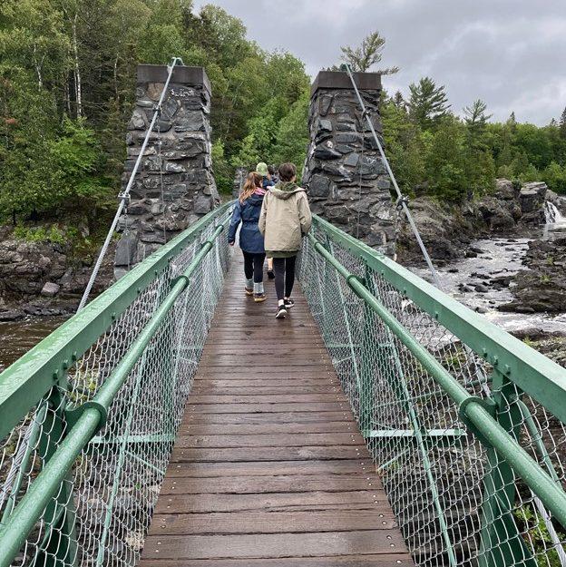 walking across bridge