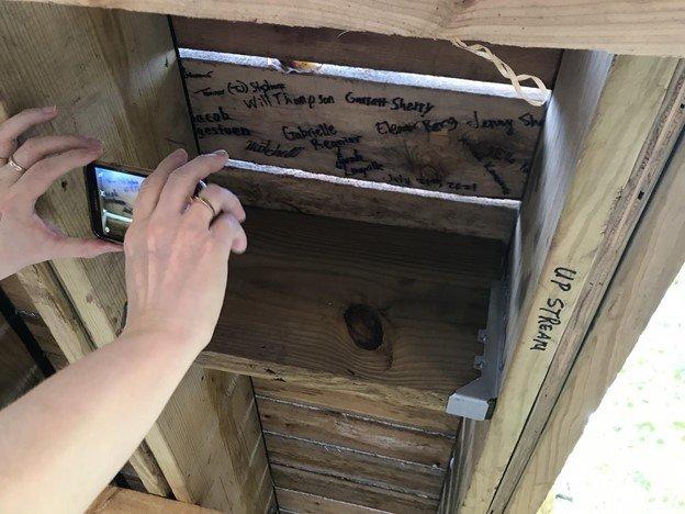 taking photo of signatures under bridge